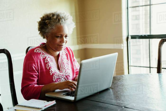 AFRICAN LADY WITH LAPTOP-AGAPEN 2