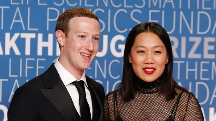 Facebook CEO Mark Zuckerberg and wifeAGAPEN 2