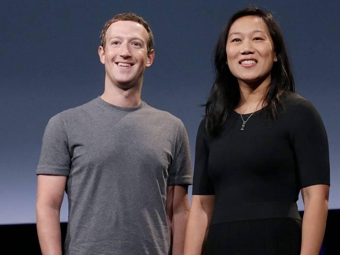 Facebook CEO Mark Zuckerberg and wifeAGAPEN
