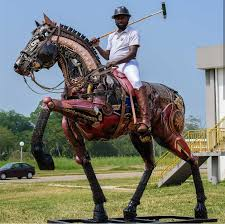 Nigerian sculptor DOTUN POPOOLA makes life-size sculptures using scrap metal and found objects.jpg1