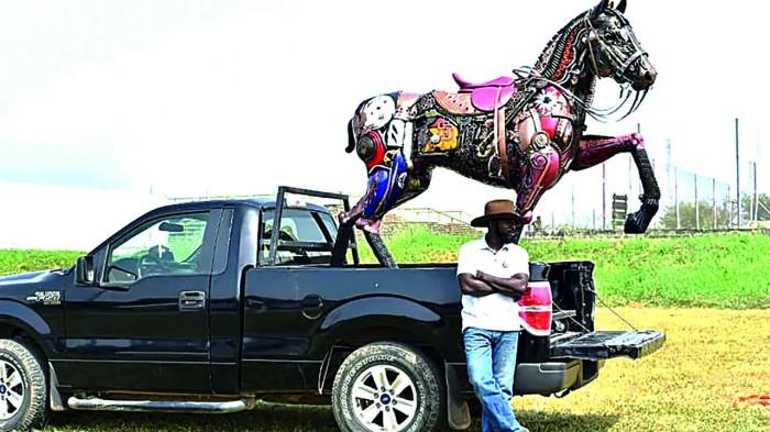 Nigerian sculptor DOTUN POPOOLA makes life-size sculptures using scrap metal and found objectsAGAPEN11