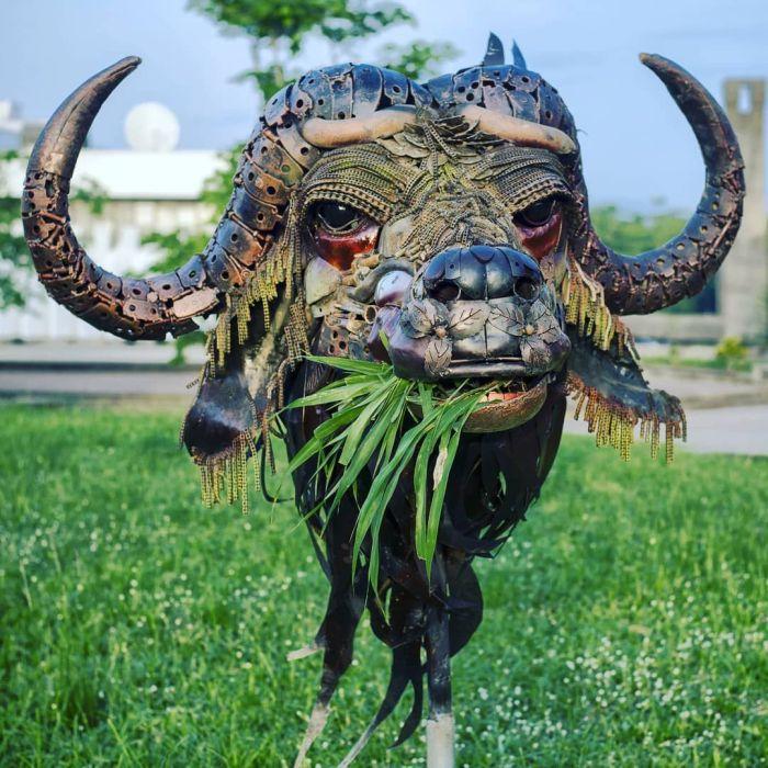 Nigerian sculptor DOTUN POPOOLA makes life-size sculptures using scrap metal and found objectsAGAPEN7